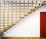 Wooden Stairs Red Door White Wall Design