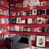 Red Book Storage Space Red Wall Black Shelves Black Sofa Cream Floor
