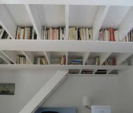White Book Storage Space White Ceiling White Stairs White Lamp White Wall