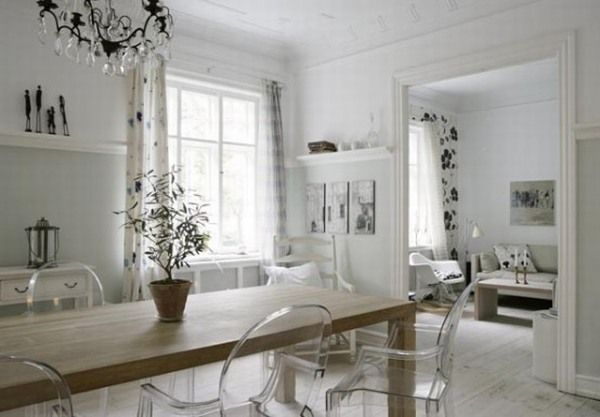 Acrylic chairs Unique indoor plant Untreated wood dining table White wall bar