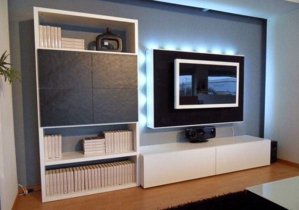 Amazing hidden light Sophisticated TV setup Modern bookcase Laminate flooring Black fur rug