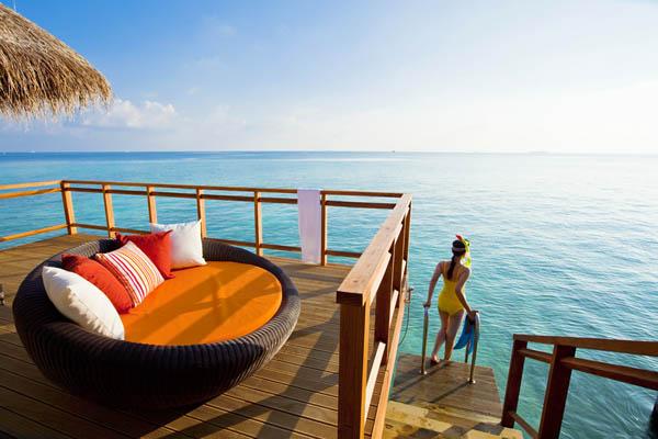 Amazing ocean view Wooden railing Dark egg chair Contemporary sofa cushions
