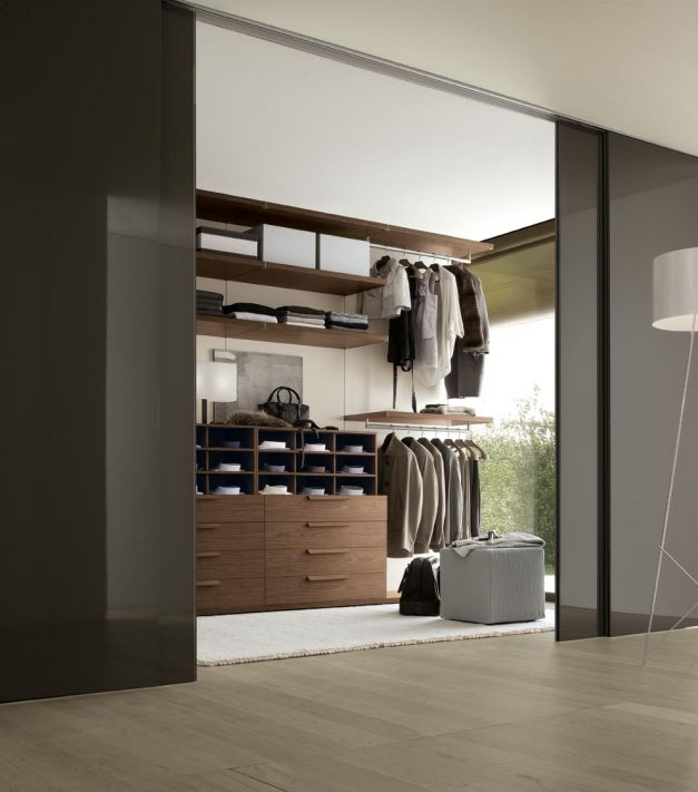 Apartment Closet Ideas Brown Glass Sliding Door Brown Wooden Cabinets Wooden Shelves White Standing Lamp