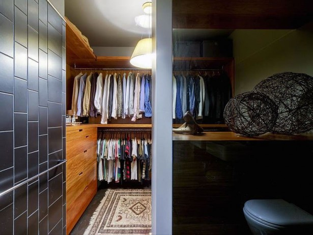 Apartment Closet Ideas Grey Glossy Wall panle WHite Hanging Lamp Wooden Cabinets Wooden Shelves