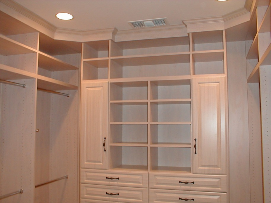 Apartment closet ideas white cabinets white shelves hidden for Apartment wardrobe design