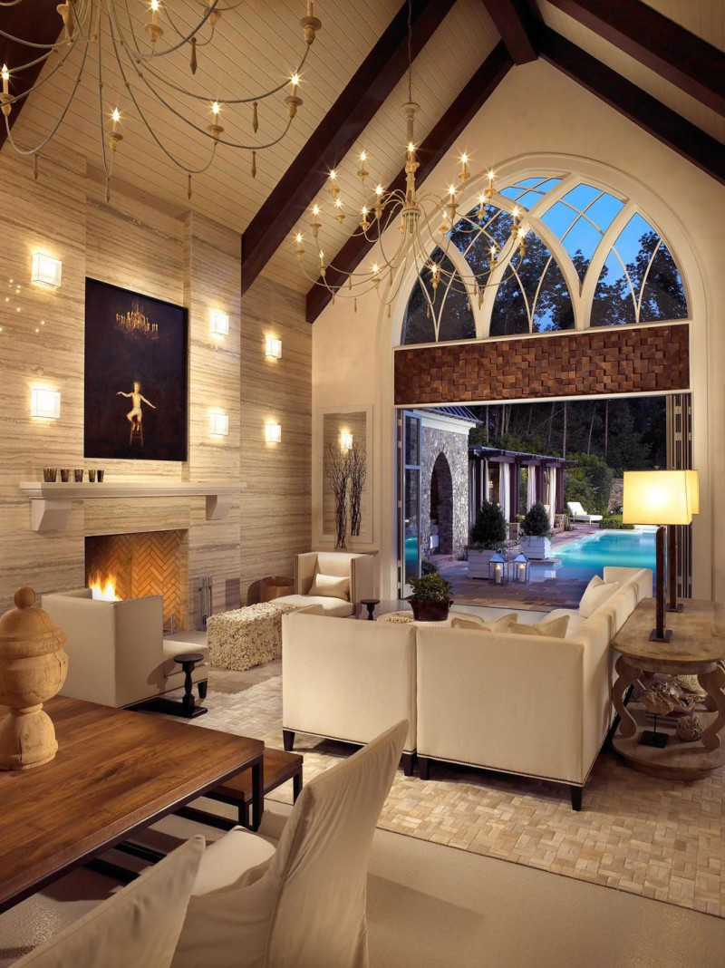 Arched entrance Classic chandeliers Comfort fireplace Pool house