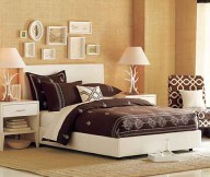 Artistic quilt Stylish table lamps Low profile bed Wall mounted headboard
