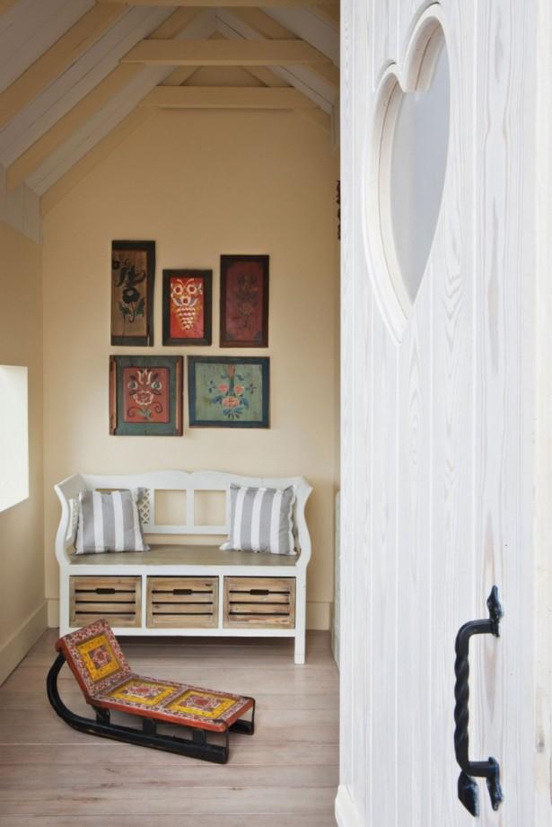 Artistic wall murals Luxurious apartment Stripes sofa cushions Metallic door handle