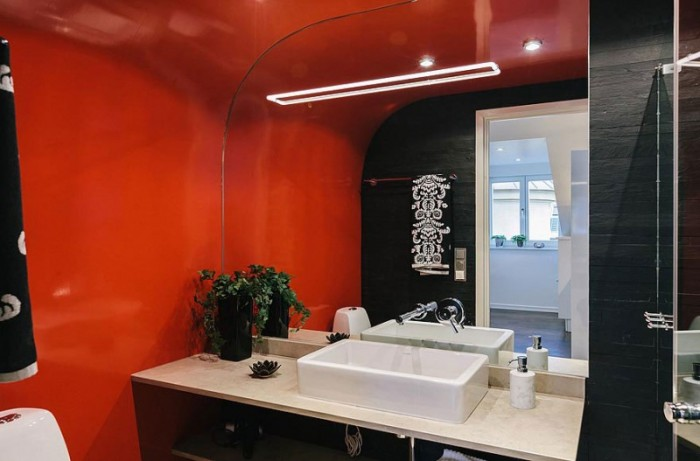 Asian Inspired Bathroom Red Wall White Sink Wide Mirror Balck Vannity Table