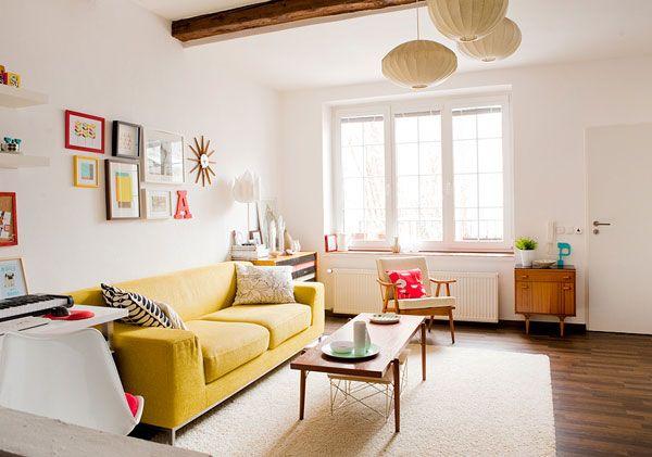 Ball pendant lamps Laminate flooring Yellow bed sofa White fur rug