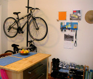 Bike Storage Ideas Black Stake Bike Hanger White Wall Wooden Kitchen ISland