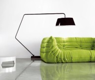 Black Arch Lamp Grey FLoor Green Sofa White Wall
