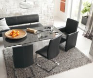 Black Chairs Black Glass Table Grey Rug White Brick Wall White Fireplace
