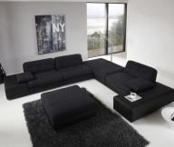 Black Couches Black Rug White Wall White Floor
