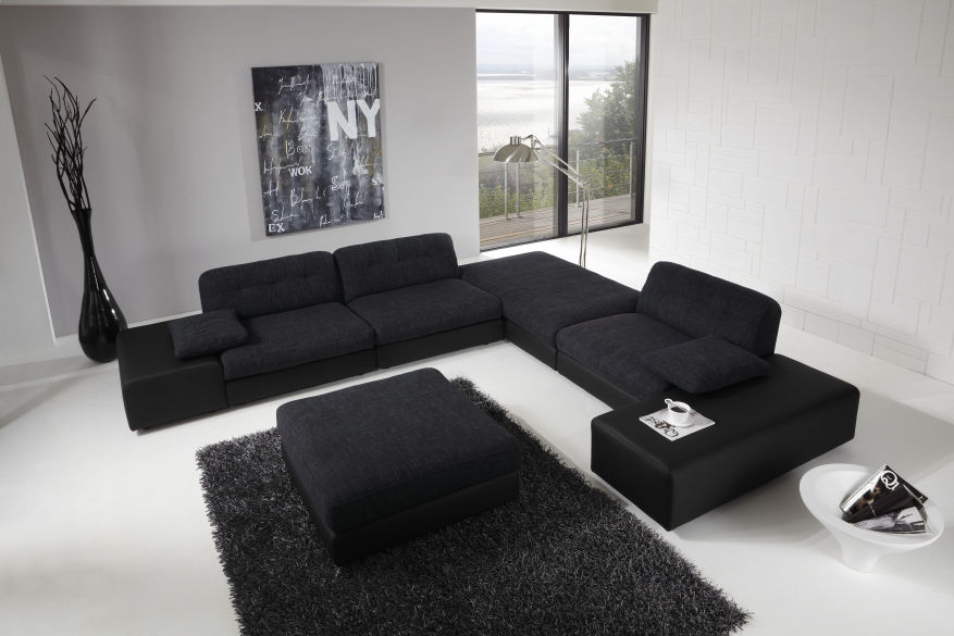 Black Couches Black Rug White Wall White Floor