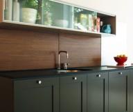 Black Counters Wooden Backsplash Glass Cabinets Cream Wall