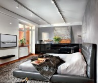 Black Leather Bed Frame Grey Rug White Wall Wooden Floor