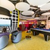 Black Polka Dot Wall Panle Yellow Carpet Floor Balck Billiard Table Black Pendant Lamps