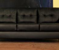 Black Sofa Minimalist Look Wooden Floor Yellow Wall