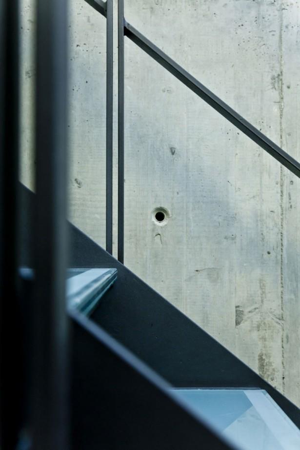 Black Stairs Black Rails Cement Wall Minimalist Look