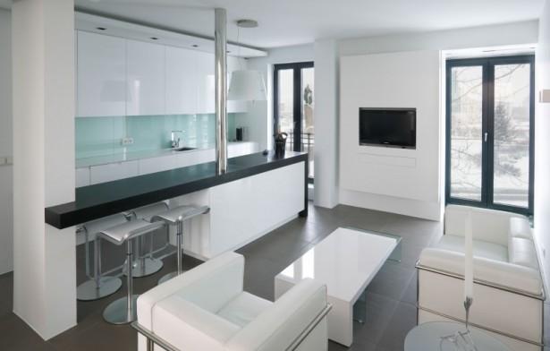Black bar countertop White kitchen island White sofa Reykjavik apartment