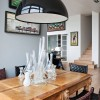 Black bowl pendant lamp Glass table tops Luxurious apartment Lacquered wooden table