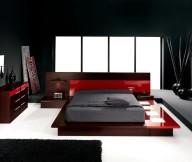 Black-fur-rug-Black-themed-bedroom-Sophisticated-low-profile-bed-Unusual-hidden-light