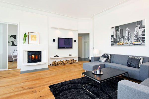 Black fur rug Elegant bed sofa Black coffee table Wall TV setup