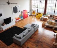 Black fur rug Grey bed sofa Laminate flooring Artistic wall mural