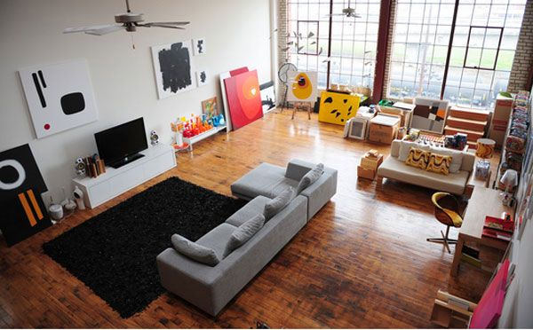 Black fur rug Grey bed sofa Laminate flooring Artistic wall mural
