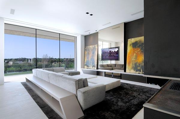 Black fur rug Sectional sofa Box coffee table Glass wall