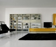 Black fur rug Shiny marble floor Yellow TV setup Black padded chairs