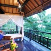 Black granite floor white bed canopy Exclusive  Beach Villas The Lush Jungle