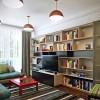 Blue Slipcovers Orange Pendant Lamp White Wooden Bookshelves Grey Glass Sliding Door Green Striped Carpet
