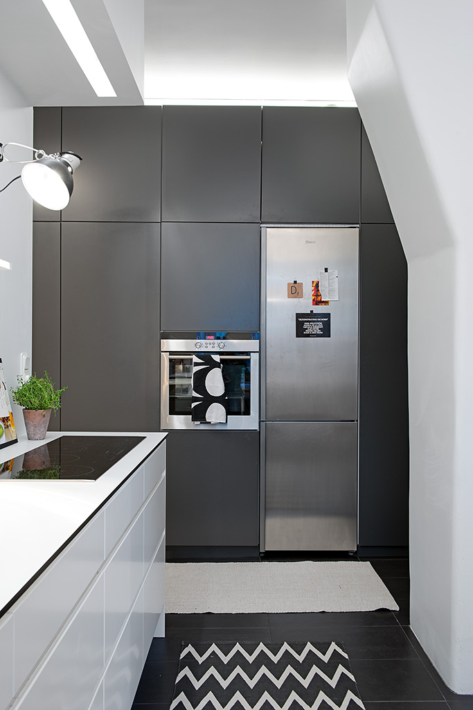 Brown CAbinets White Counter Black Wooden Floor White Wall