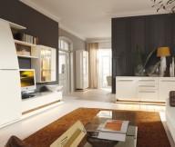 Brown Carpet White Cabinets Black Wall Panel White Sofa