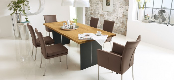 Brown Leather Chairs Wooden Dining Table White Floor White Hanging Lamps Brown Brick Wall