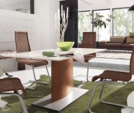 Brown Rattan Chairs Green Carpet Black Arch Lamp Glass Table
