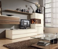 Brown Rug Black Chair White Television Cabinet Grey Wall Panel