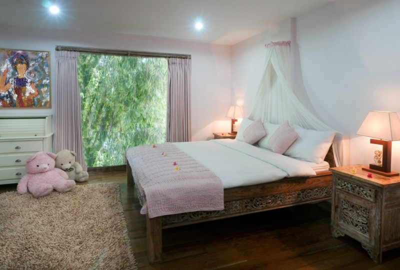 Brown Rug Wooden Bed Frame Pink Curtain White Wall