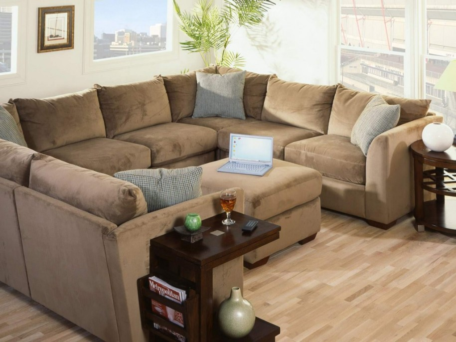 Brown Sofa Grey Cushions Wooden Floor White Wall
