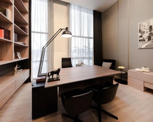Brown Wooden Desk Black Chairs WOoden Floor Wooden Bookshelves