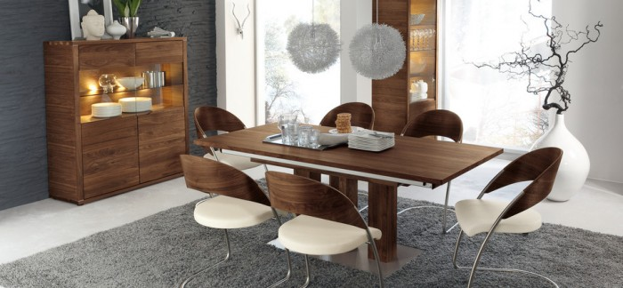 brown wooden dining table cream brown chairs grey rug grey hanging