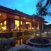 Circular architecture pool Aquatic plants Cozy verandah Wooden furniture