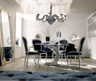 Classic Italian Interiors black chairs futuristic table design