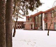 Contemporary house Snowy courtyard Leafy trees Two storey building