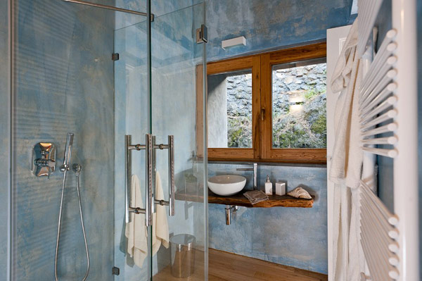 Contemporary shower enclosure Stainless steel shower head Untreated wooden wall bar Porcelain basin