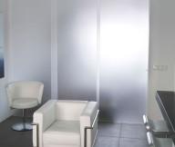 Contemporary white sofa Reykjavik apartment Black floor tile