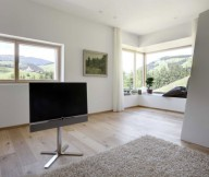 Contemporary wooden house Sophisticated TV setup Glass bay window Wooden floor