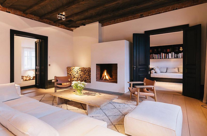 Convenient fireplace Stunning apartment White fur rug White sofa
